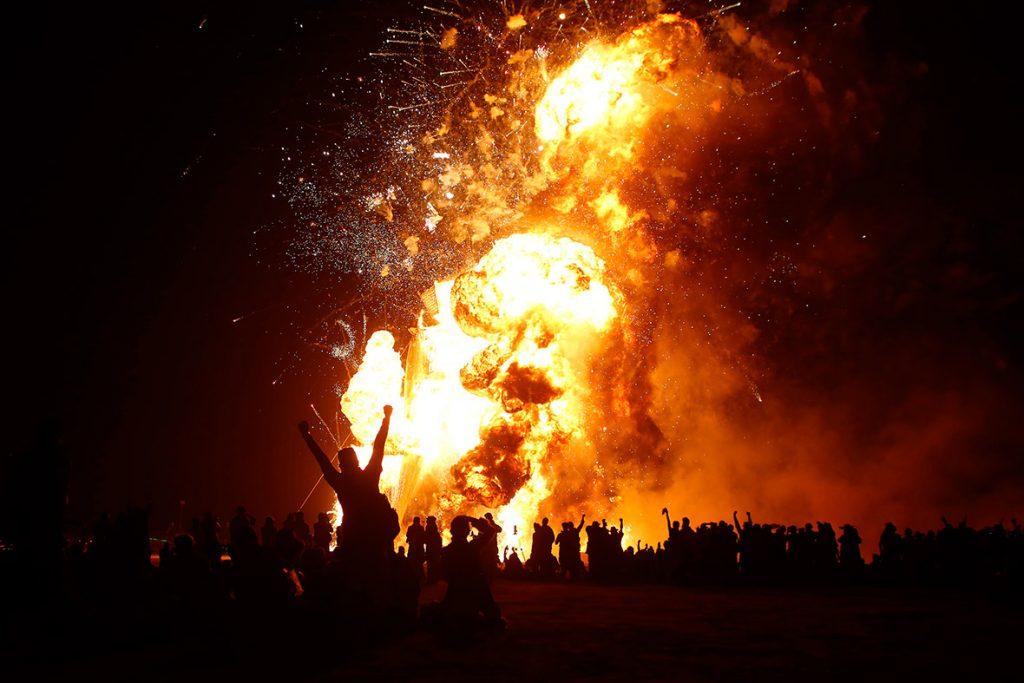 Revellers cheer as the Man burns.(Jim Urquhart Reuters)