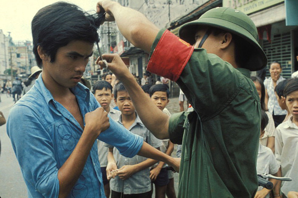 VIETNAM - APRIL 01: The Fall of Saigon, Vietnam in April, 1975 - The Vietcong cutting hair and
