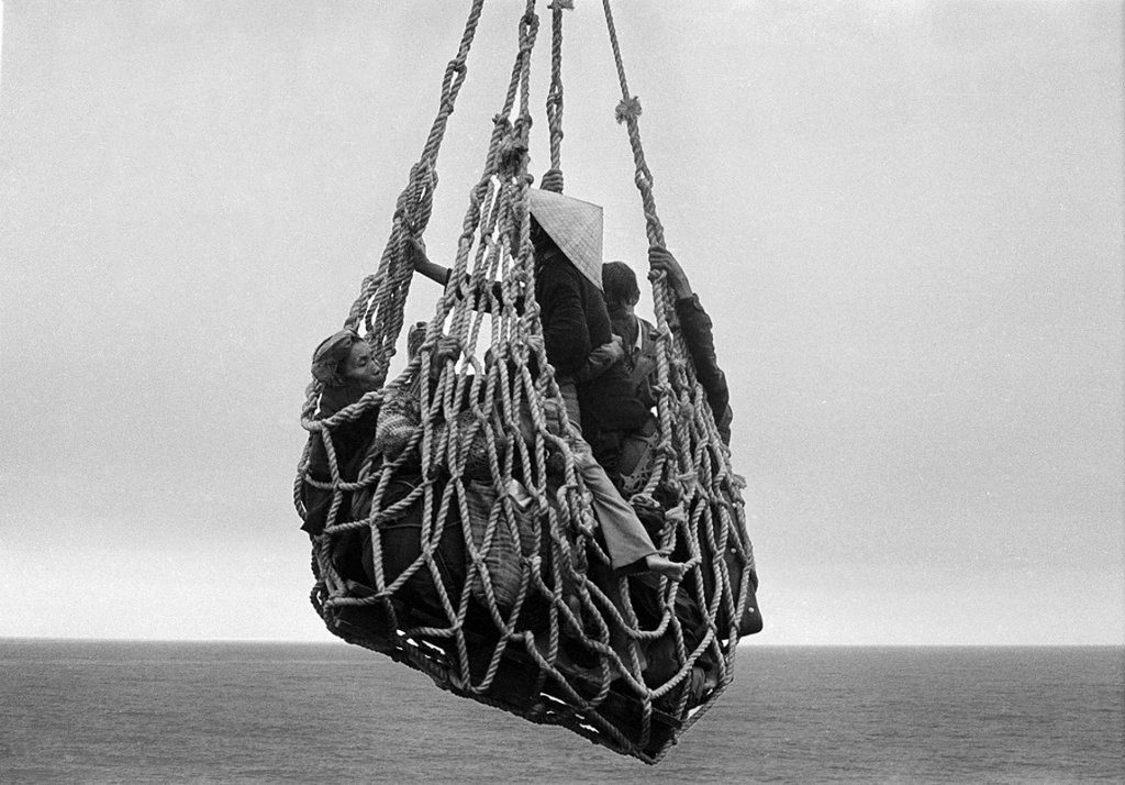 DA NANG 1975 A cargo net lifted refugees from a barge onto the S.S. Pioneer Contender for evacuation from Da Nang in 1975. It took eight hours for the freighter to load 6,000 people. Peter O'Loughlin/Associated Press