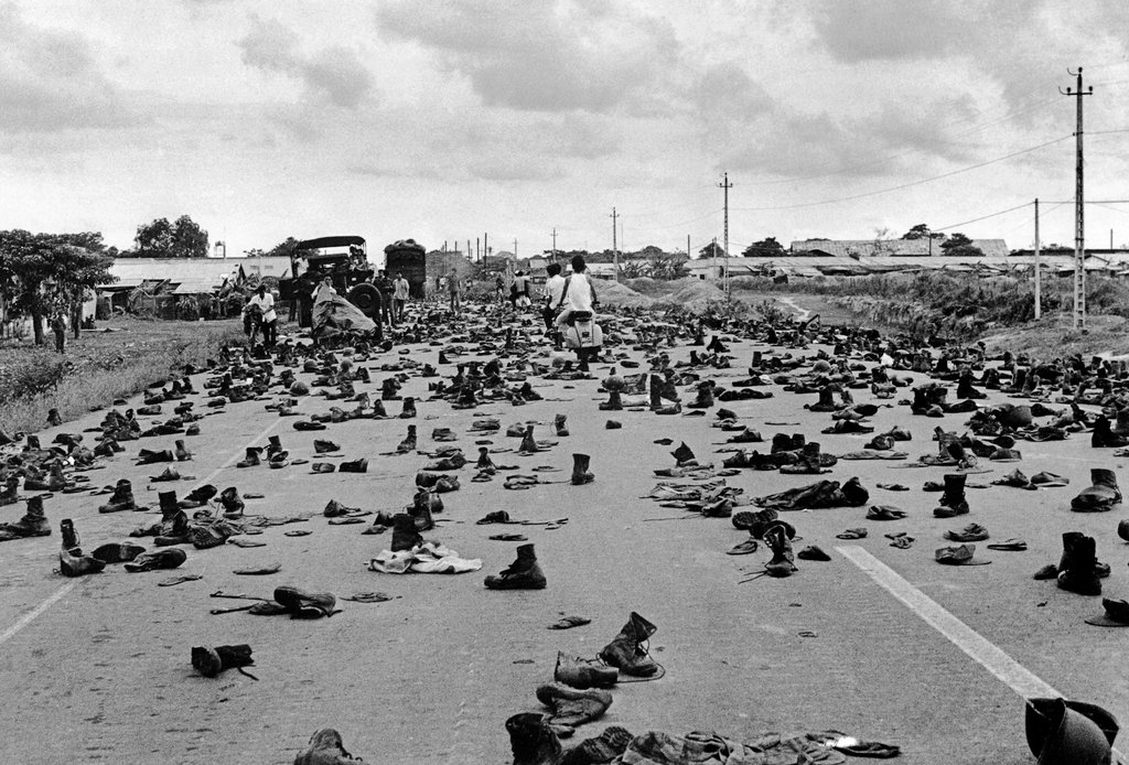 Fleeing South Vietnamese soldiers left their uniforms behind on the outskirts of Saigon to hide their military status from the victors. April 30, 1975. Duong Thanh Phong/Patrick Chauvel Foundation