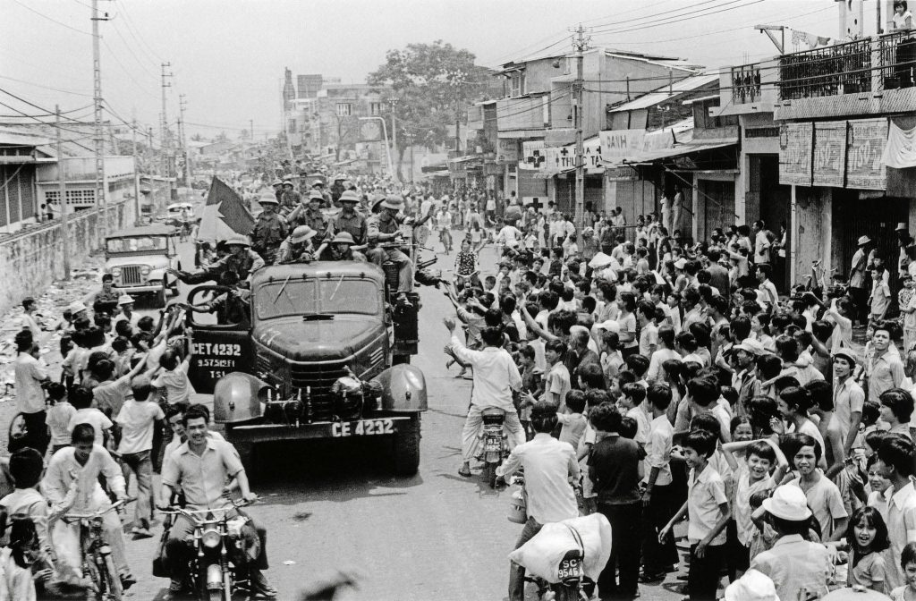 SAIGON April 30, 1975 Saigon residents take to the street to welcome the arrival of communist troops on trucks after the fall of Saigon which marked the end of the Vietnam War. Picture: AFP