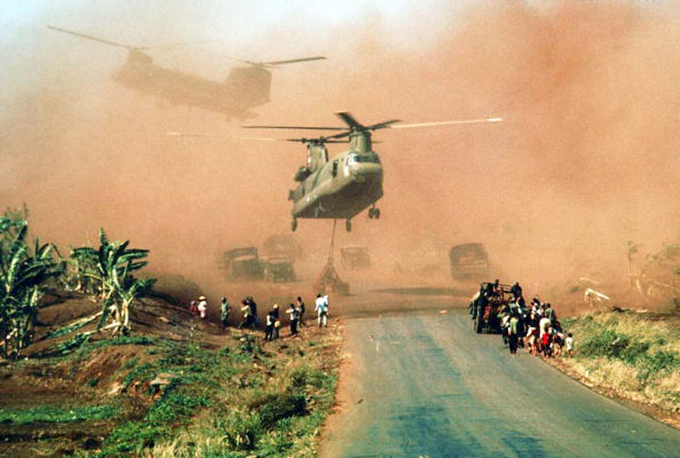 Fall of Saigon 1975 Two Chinook helicopters hover above a road as they assist in evacuating supplies and soldiers of the South Vietnamese (ARVN) 18th Division and their families from Xuan Loc, Vietnam, mid April, 1975. The road is likely Highway 1. (Photo by Dirck Halstead/The LIFE Images Collection/Getty Images)