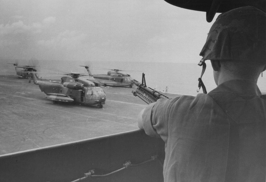 CH-53 Sea Stallions are poised on the carrier deck for the flight to Saigon. Jim Stanitz Collection