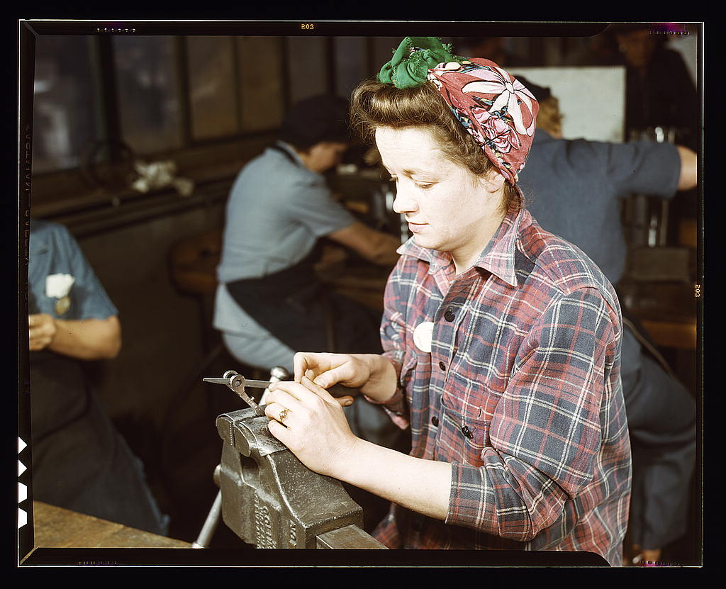 Hollem, Howard R.,, photographer.   One of the girls of Vilter [Manufacturing] Co. filing small gun parts, Milwaukee, Wisc. One brother in Coast Guard, one going to Army.   1943 Feb.