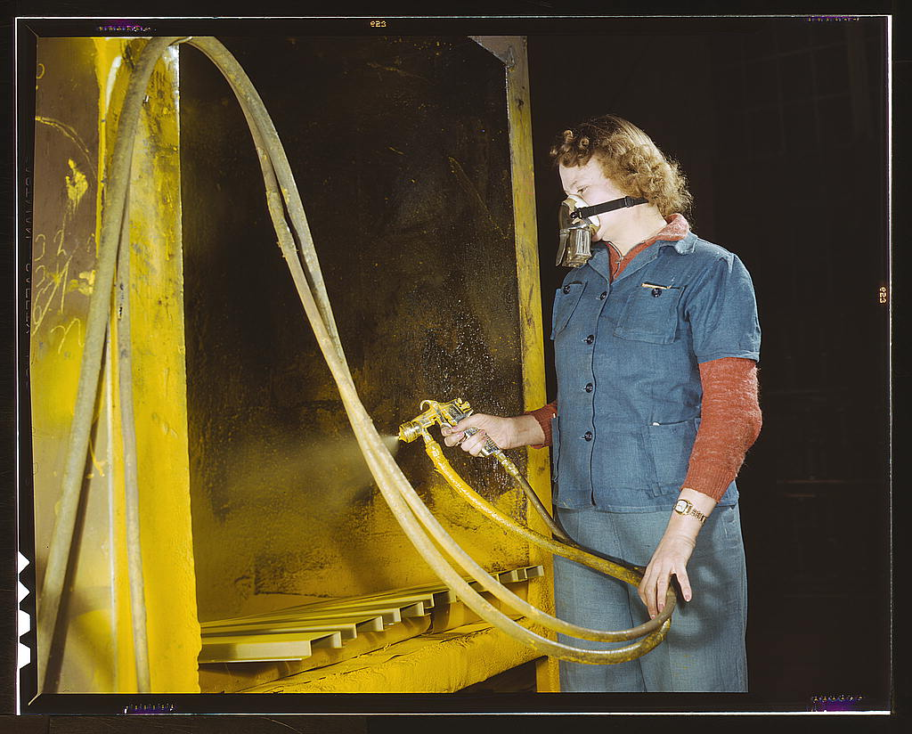 Hollem, Howard R.,, photographer.   War production workers at the Heil Company making gasoline trailer tanks for the U.S. Army Air Corps, Milwaukee, Wisconsin. Elizabeth Little, age 30, the mother of two children, spraying small parts. Her husband runs a farm   1943 Feb.