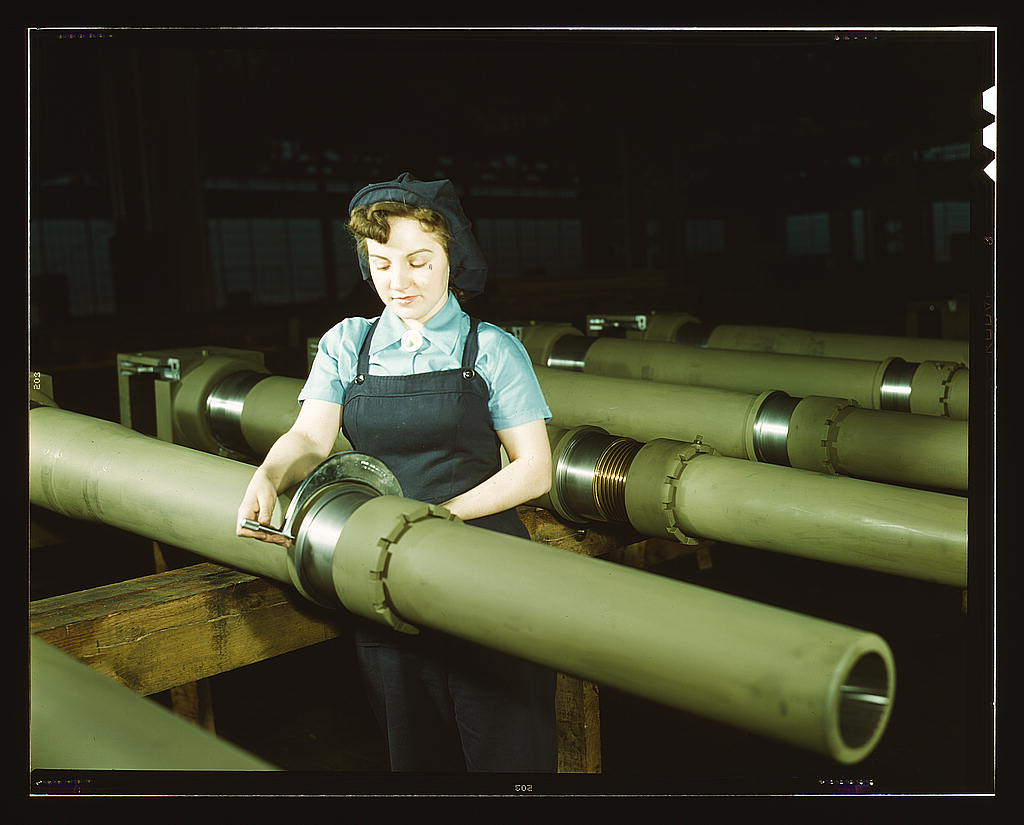 Hollem, Howard R.,, photographer.   Gist inspector, Mrs. Mary Betchner inspecting one of the 25 cutters for burrs before inserting it in the inside of a 105mm. howitzer at the Milwaukee, Wis. plant of the Chain Belt Co. Her son is in the army; her husband is in war work   1943 Feb.