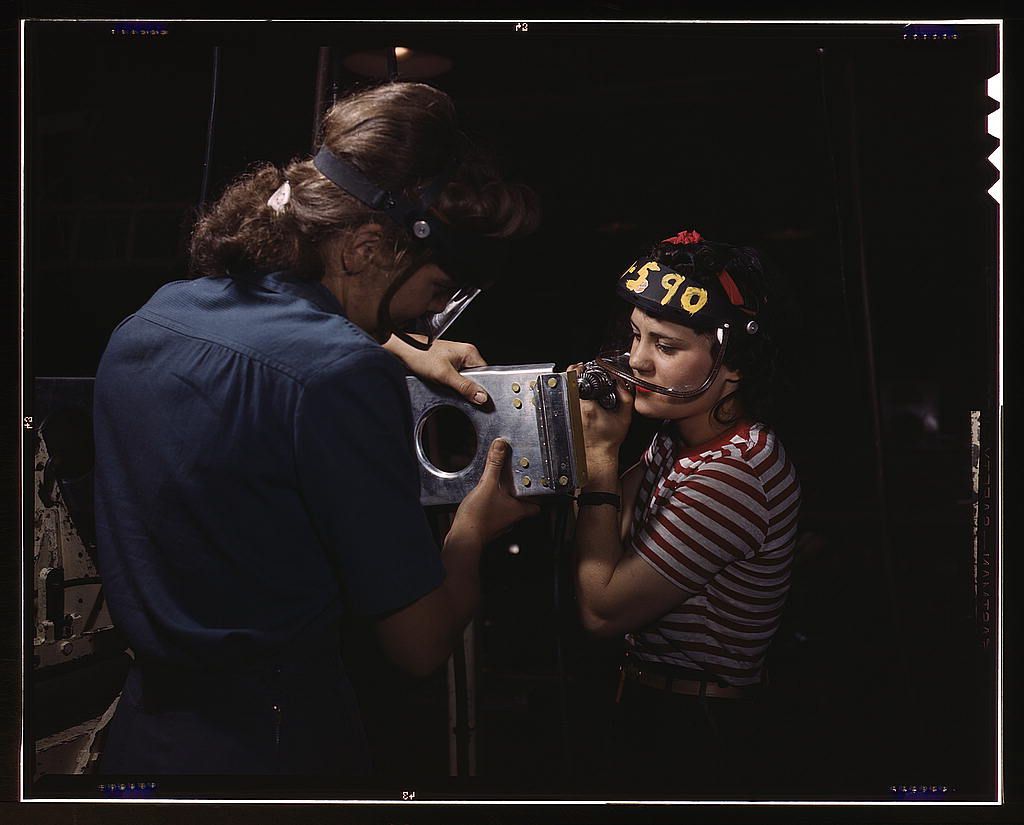 Palmer, Alfred T.,, photographer.   Two women employees of North American Aviation, Incorporated, assembling a section of a wing for a P-51 fighter plane   1942 Oct.