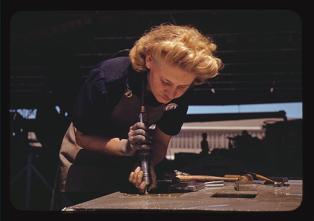 Hollem, Howard R.,, photographer.   Working in the Assembly and Repair Dept. of the Naval Air Base, Corpus Christi, Texas   1942 August