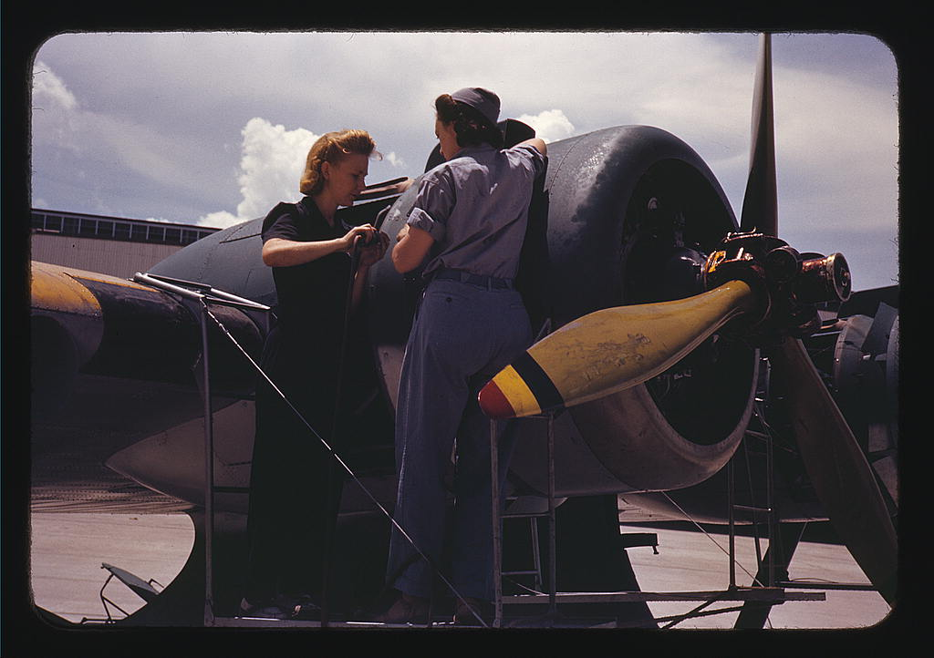 Hollem, Howard R.,, photographer.   Bowen, a riveter, and Olsen, her supervisor, in the Assembly and Repair Dept. at the Naval Air Base, Corpus Christi, Texas   1942 August