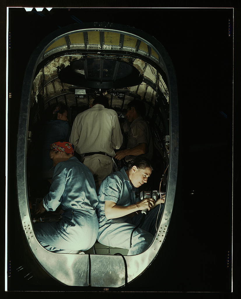 Hollem, Howard R.,, photographer.   Working inside fuselage of a Liberator Bomber, Consolidated Aircraft Corp., Fort Worth, Texas   1942 Oct.