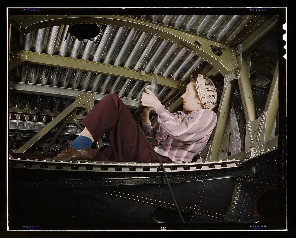 Palmer, Alfred T.,, photographer.   An A-20 bomber being riveted by a woman worker at the Douglas Aircraft Company plant at Long Beach, Calif.   1942 Oct.