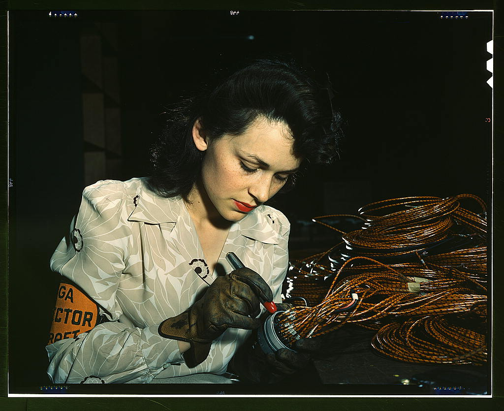 Bransby, David,, photographer.   Woman aircraft worker, Vega Aircraft Corporation, Burbank, Calif. Shown checking electrical assemblies   1942 June