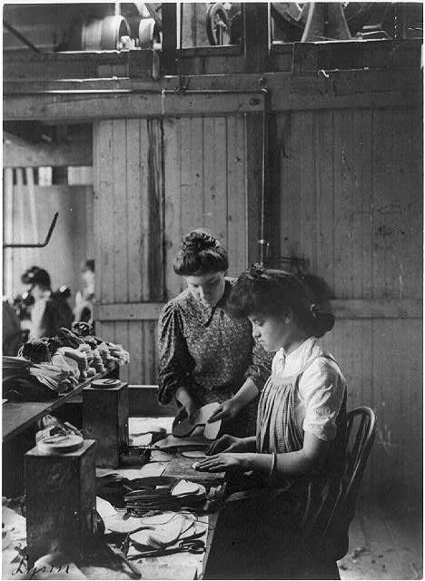 Shoe factories, Lynn, Mass 2 women working in shoe factory
