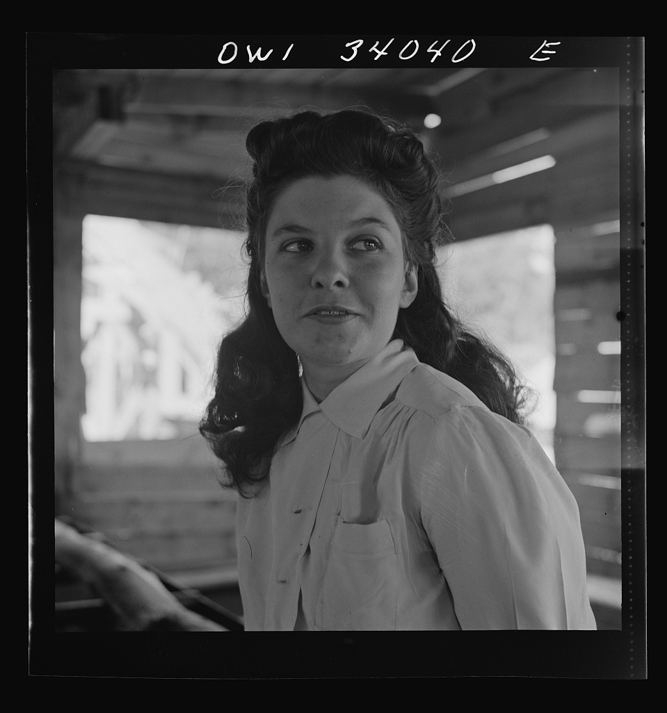 Turkey Pond, near Concord, New Hampshire. Women workers employed by a U.S. Department of Agriculture timber salvage sawmill. Barbara Webber, twenty-one year old edger, finds her job harder physically than