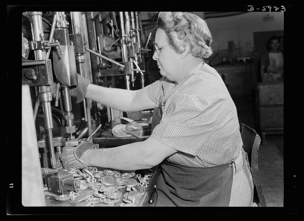 Women in industry. Flare gun production.