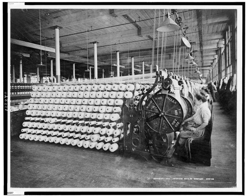 Women working at machines, beaming and inspecting yarn, American Woolen Company, Boston