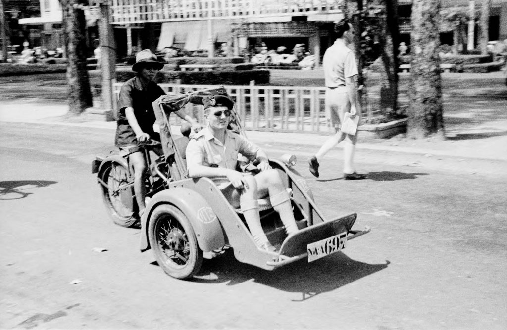 1950 - French official riding in pedicab on Saigon street - Le Loi Avenue - Photo by Harrison Forman