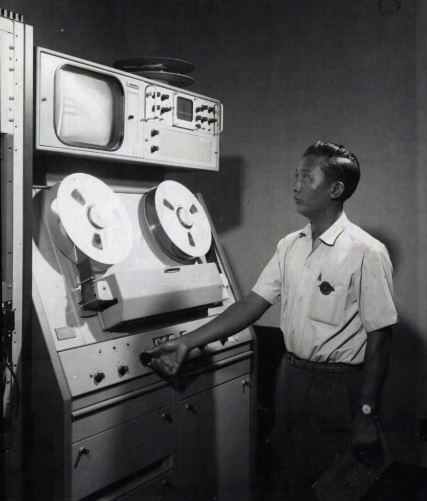 Saigon 1967 - Đài truyền hình VNCH An Audio-Video engineer check the AMPEX Video-tape recorder, in the RVN TV studio, as the nightly newscast comes to an end. 23 Jan 1967