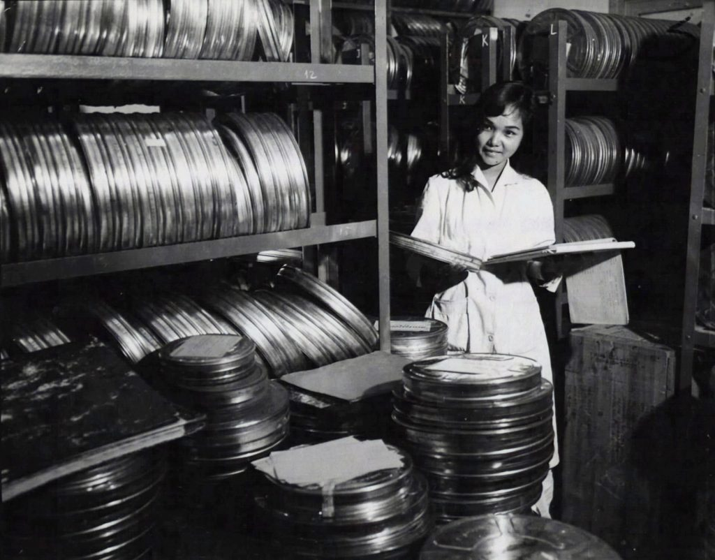 Saigon 1967 - Đài truyền hình VNCH A film librarian checks her log for an educational film, needed for an RVN TV broadcast. This library contains thousands of films in all categories. 23 Jan 1967