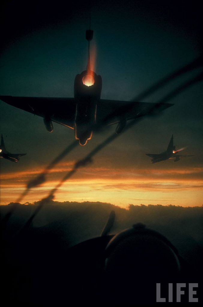 American F-102 interceptor fighters flying dawn patrol mission during Vietnam war. Location: Vietnam Date taken: 1966 Photographer: Larry Burrows