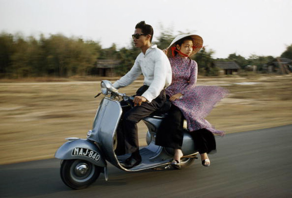 SAIGON 1961 - Photo by Wilbur E. Garrett VIETNAM - OCTOBER 10: A nattily dressed young couple zip down the road on a motor scooter, Saigon, Vietnam (Photo by Wilbur E. Garrett/National Geographic/Getty Images)