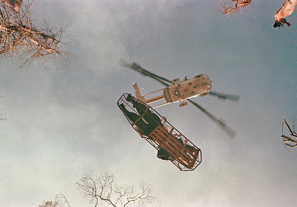 A helicopter lifts a wounded American soldier on a stretcher during Operation Silver City in Vietnam, March 13, 1966. (AP Photo)