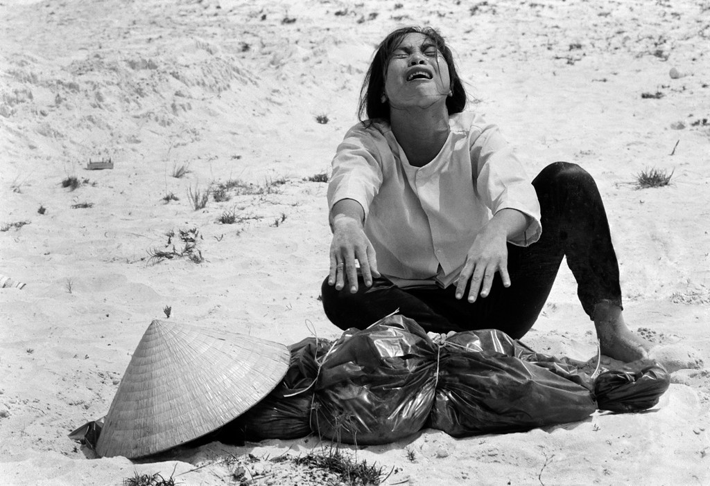 A South Vietnamese woman mourns over the body of her husband, found with 47 others in a mass grave near Hue, Vietnam in April of 1969. (AP Photo/Horst Faas, File