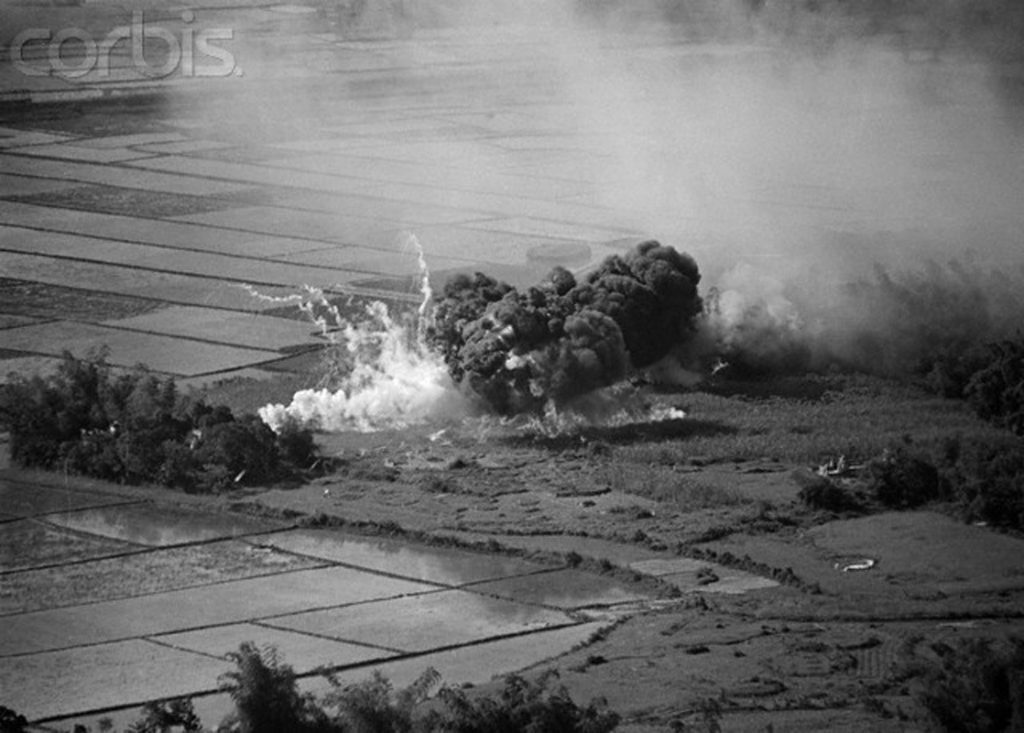 02 Dec 1965, Da Nang, South Vietnam --- A napalm bomb, dropped on suspected Communist target, sends up billows of smoke after being released from a U.S. Air Force plane south of Da Nanag recently. Communist targets were the objectives of 140 attack sorties from the nuclear powered aircraft carrier, USS Enterprise, which went to war for the first time December 2nd. --- Image by © Bettmann/CORBIS