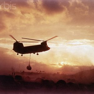 03 Nov 1966, An Khe, South Vietnam --- 11/3/1966-An Khe, South Vietnam: A CH-47A Chinook helicopter from the Army's 228 Aviation Battalion lifts a load of ammunition for 1st Cavalry Division airmobile troops. --- Image by © Bettmann/CORBIS