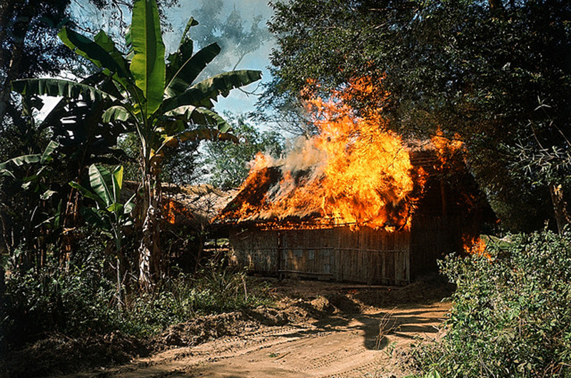14 Jan 1967, Ben Suc, South Vietnam --- 1/14/1967-Ben Suc, South Vietnam- Operation Cedar Falls. Bamboo huts go up in flames during an effort by U.S. Army infantrymen to completely level the Vietcong stronghold of Ben Suc. Vietnamese were earlier evacuated from the village area. --- Image by © Bettmann/CORBIS