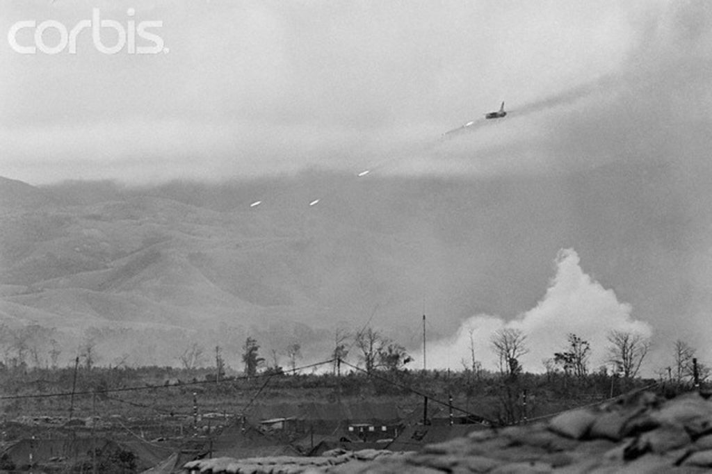 04 Mar 1968, Khe Sanh, South Vietnam --- Some Bolts from the Blue. Khe Sanh, South Vietnam: An American jet fires rockets into Communist positions in the hills surrounding the U.S. Marine outpost at Khe Sanh. U.S. planes hit enemy forces as close as 100 yards from the perimeter of the camp. --- Image by © Bettmann/CORBIS