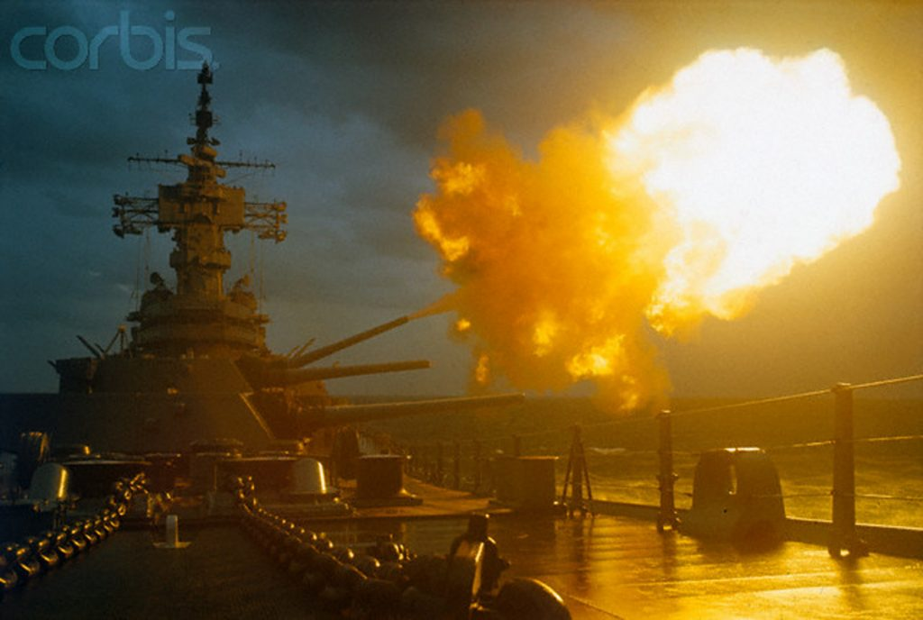 30 Sep 1968 --- The battleship USS New Jersey fires its 16-inch guns into the demilitarized zone here 9/30. These were the first shells fired by the New Jersey in the Vietnamese war. The vessel is the only battleship on active duty in the U.S.Navy. --- Image by © Bettmann/CORBIS