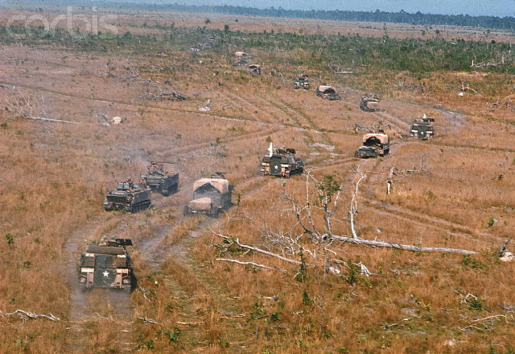 ca. January 1969, Vietnam --- A 1st Division 11th Armored Regiment armored track company moves up to take position at Michelin Plantation, Vietnam. --- Image by © Tim Page/CORBIS