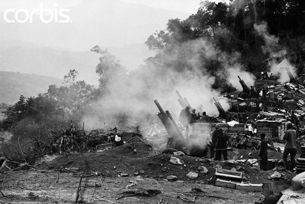 12 Feb 1969, A Shau, South Vietnam --- A SHAU, SOUTH VIETNAM-2/12/69-: Smoke hangs over 105mm howitzers as US marines pour artillery shells into the A Shau valley, five miles from the Laotian border, in support of about 5,000 allied troops Feb. 12. The allied troops jumped into A Shau Jan. 20, but kept the operation, named Dewey Canyon, secret until Feb. 12 to give the Communists as little warning as possible. --- Image by © Bettmann/CORBIS