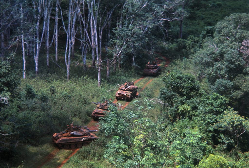 17 Oct 1969, Saigon, Vietnam --- Saigon: The 11th Armored Cavalry armored personnel carriers and tanks sweep into rubber plantation area at Loc Ninh and Quan Loi October 17th. --- Image by © Bettmann/CORBIS