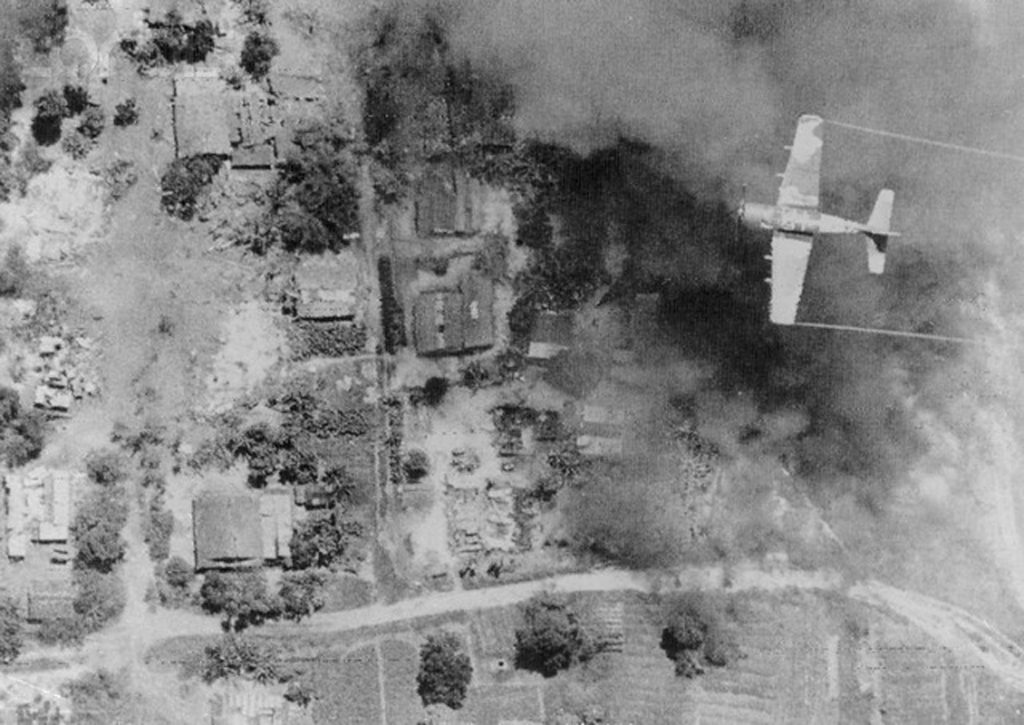 October 112, 1972, Thang Phung[?], South Vietnam --- South Vietnam: A South Vietnamese Skyraider makes a bombing run over this hamlet, 17 miles north of Saigon. Below smoke pours from destroyed buildings. Communist soldiers have been stuck here, Highway 13, for 3 days. --- Image by © Bettmann/CORBIS