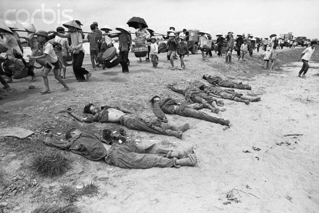 06 Apr 1972, Quang Tri City, South Vietnam --- 4/6/1972-Quang Tri City, South Vietnam- Dead North Vietnamese soldiers are lined up beside road as refugees from Quang Tri City City flee from fighting, 4/5, five miles south of Quang Tri. --- Image by © Bettmann/CORBIS