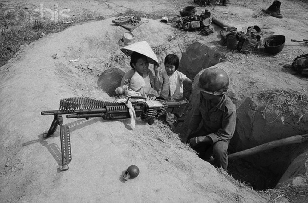 21 Mar 1973, Saigon, South Vietnam --- Visit with Daddy...A South Vietnamese soldier is visited by his wife and children March 21 while he is on guard duty in trench along Highway 13, some 20 miles north of Saigon. --- Image by © Bettmann/CORBIS