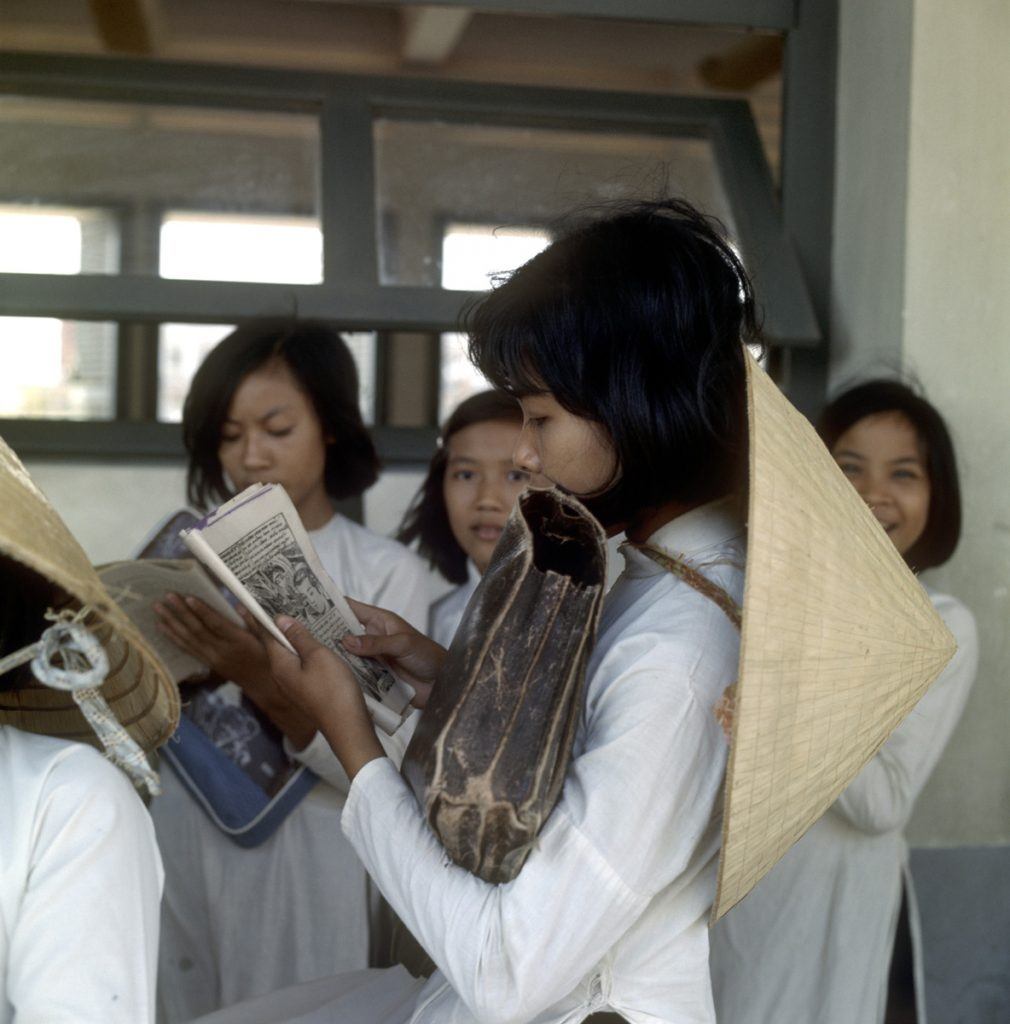 Group of schoolgirls in aodai and traditional hats, Vietnam, 1967 A set of slides by Henk Hilterman