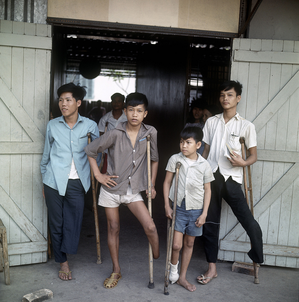 Vietnamese handicapped boys with missing limbs on crutches, Vietnam, 1967.