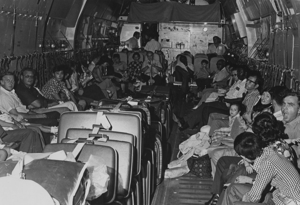 Evacuees line the inside of a C-141 Starlifter as it flies them to safety from Saigon to Clark Air Base. Jim Stanitz Collection