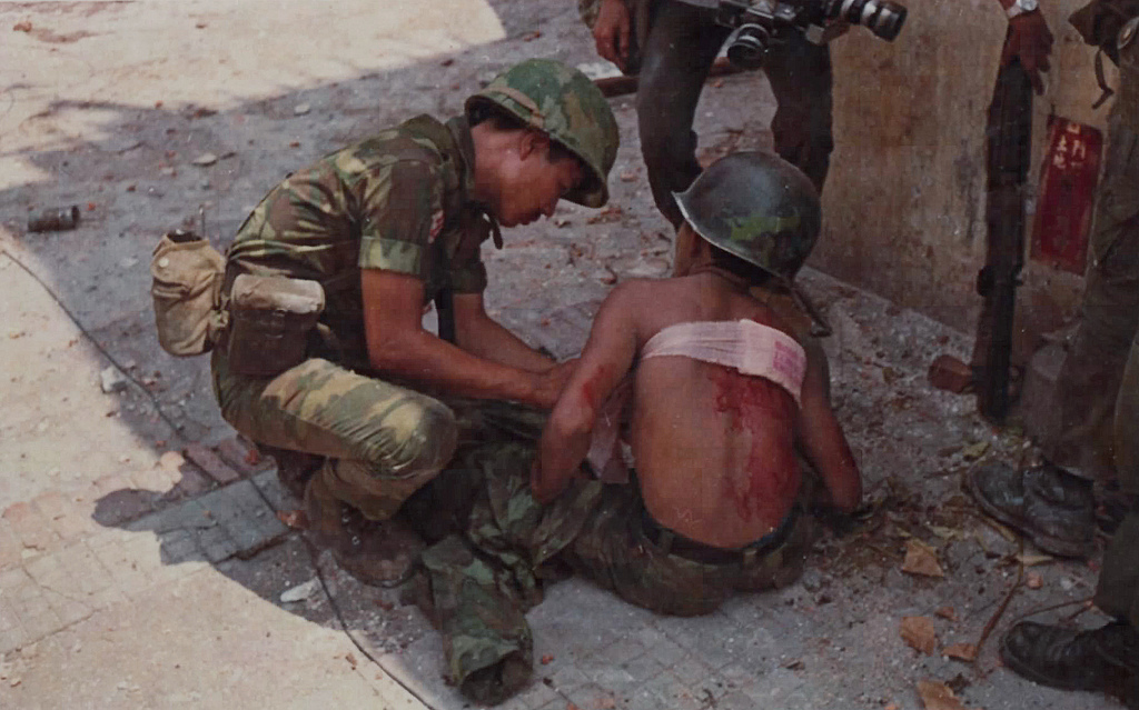 A medic of the 35th ARVN Ranger Bn treats a Ranger who was wounded by a Viet Cong sniper during the street fighting in Cholon. source: fold3.com