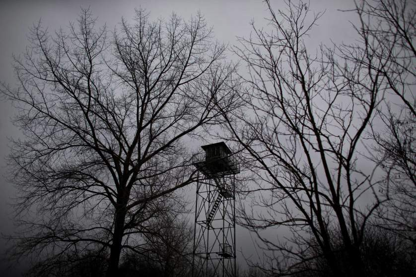 In this photo taken Thursday, Feb. 26, 2015, a watchtower left over from the Cold War era is seen meters away from the Serbian border with Hungary close to Kelebija, 150 kilometers north of Belgrade, Serbia. Thousands of migrants from the Middle East and Africa have been flocking to Serbiaís border with Hungary, hoping to cross illegally into the European Union in search of a better life. (AP Photo/Marko Drobnjakovic)