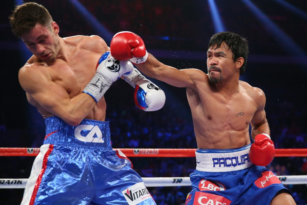 MACAU - NOVEMBER 23: Manny Pacquiao of the Philippines and Chris Algieri of the United States exchange punches during the WBO world welterweight title at The Venetian on November 23, 2014 in Macau, Macau.